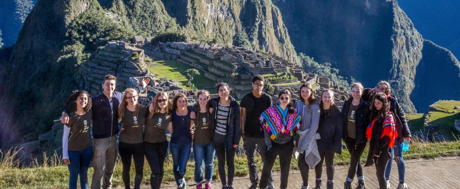 Teenage volunteers doing work with children in Peru, go on an organised weekend trip to Mach Picchu.